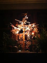 Brent Budsberg and Shana McCaw created this makeshift Christmas tree from scraps from home renovation projects.