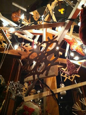 Brent Budsberg made these wooden snowflake ornaments to hang from a makeshift Christmas tree of home renovation castoffs.