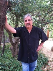 Arizona historian Jack August has died.