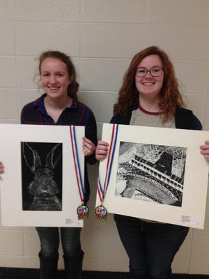 Flippin  art students Erika Stoner, left, and Ashley Vredenburg were recently awarded first place in the Arkansas Art Educators State Youth Art Show. Each young artist represented the northwest Arkansas region for their grade level at the AAE State Youth Art Show.