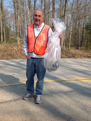 Jim Pasqualucci shows some of the trash he has collected during the Bay Shore Property Owners Association spring cleanup along Bay Shore Drive.