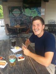 Trailhead customer Daniel McBride enjoys a hot dog