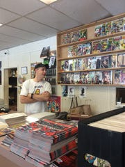 Bill Langford talks to a customer about the new Spider-Man