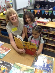 Volunteers read to children for an hour a week through