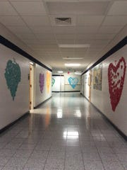 Paper hearts adorn the walls of the D.C. Everest Middle School.
