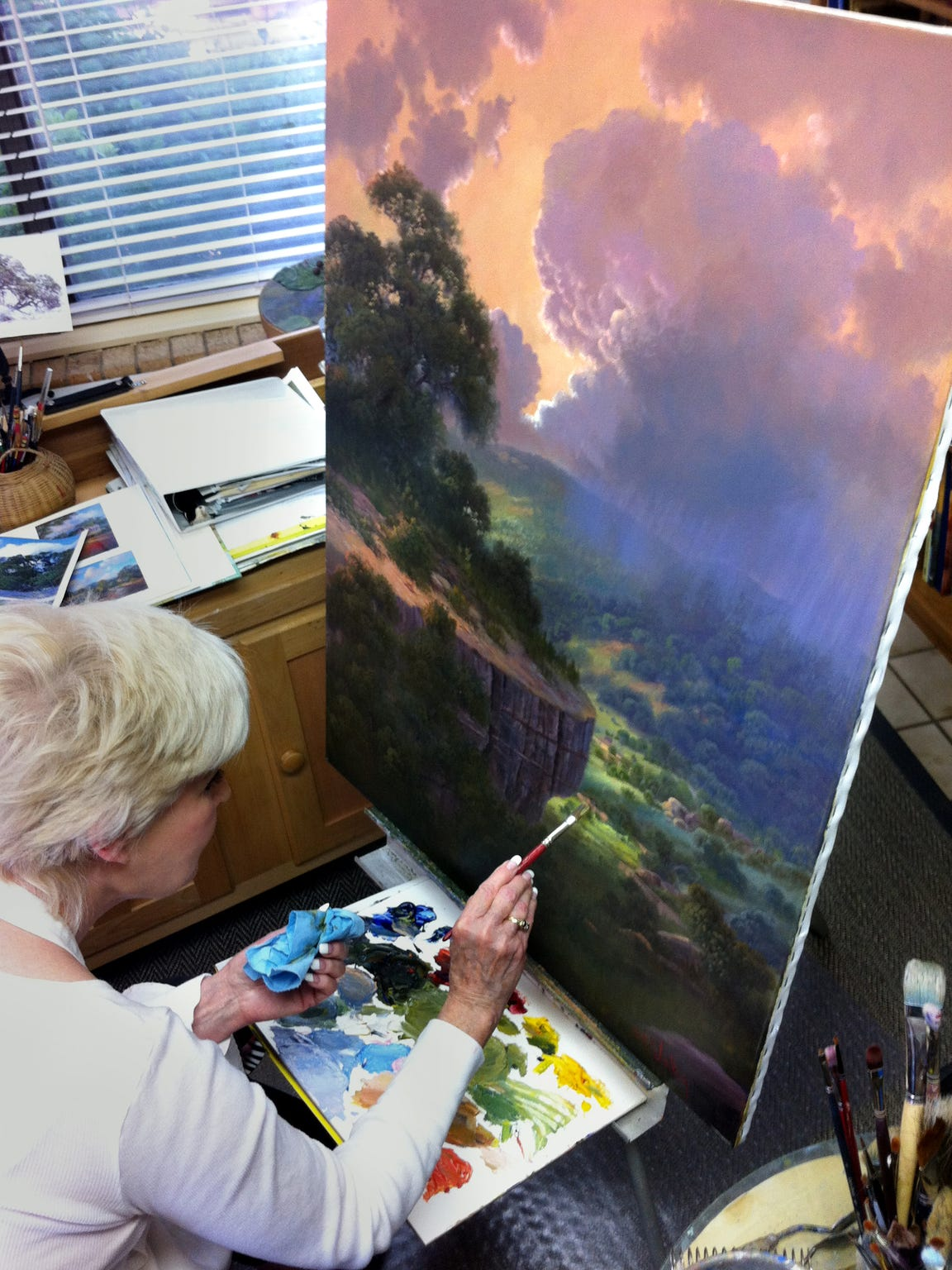 "Kay Walton removed a Texas landscape painting from a wall in her home and added George Washington to a cliff to provide an image that became the cover of Rob Westman's ""George Washington: Providence."""