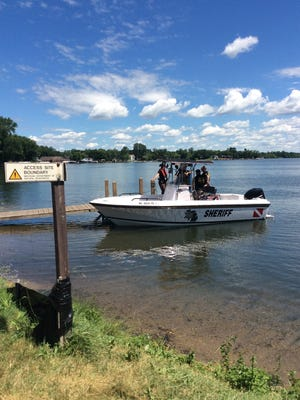 Members of the Oakland County Sheriff's Office return to the DNR launch on the west side of White Lake, located in Highland Township, on Tuesday, July 17, 2018.