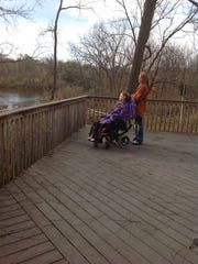 Wehr Nature Center, 9701 W. College Ave. in Franklin, has been working to allow visitors with disabilities more access to features. One of the features worked on is the viewing deck which is designed with areas specifically for wheelchairs. Here, a visitor enjoys a natural view on the deck.