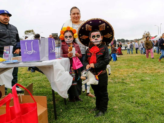 A young boy who won the first round of La Catrina contest