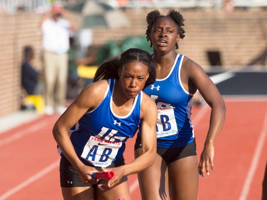 Amaya Chadwick takes hand off from Khamil Evans as they compete in the High School Girls Distance Medley on Friday at Penn Relays in Philadelphia, Pa. on April 28, 2017.