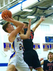 Waynesboro's Cameron Keck looks to shoot over a South