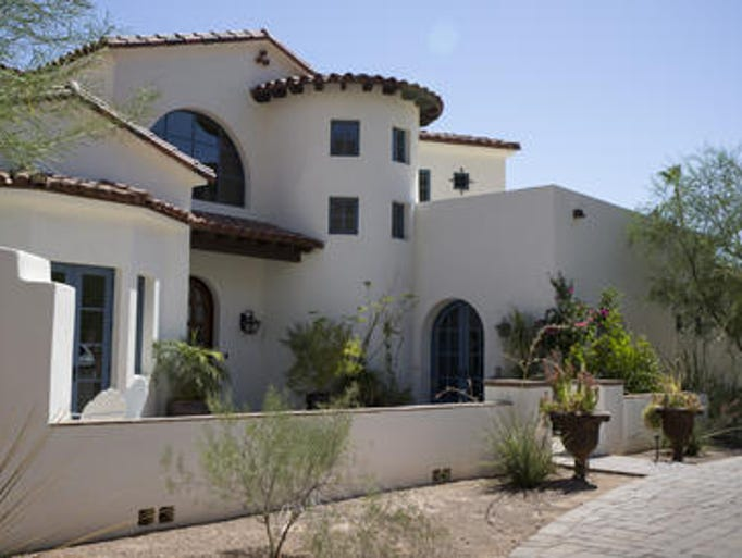 The exterior of a Phoenix home staged by Janelle Joyce. Janelle owns a franchise of Showhomes, a company that provides live-in caretakers for luxury homes for sale that otherwise would be vacant. The thought is that furnished, lived-in homes are more likely to sell.