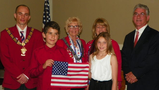 Fremont Elks celebrate Flag Day. Front row from left are essay contest winners Dominic Rodriguez and Liz Rellinger. Back row from left, Kris Cantrell, Mary Beaston, Molly Velez and Judge Robert Hart.