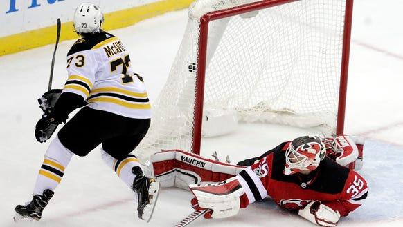 Boston Bruins defenseman Charlie McAvoy (73) scores