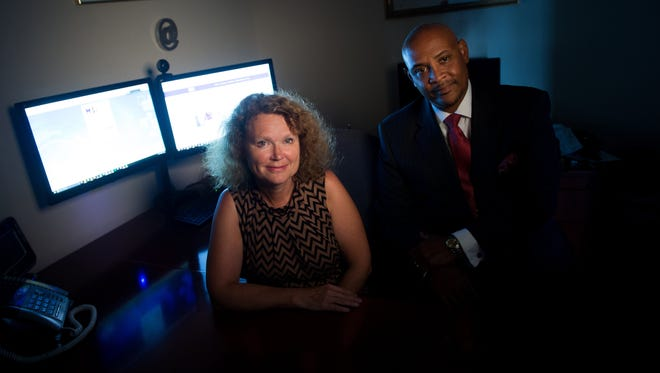 Jayne Moore, left, and Terrance Moore at Moore Solutions.