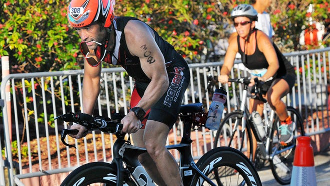 Triathletes start the bike portion during the 31st Rotary Pineapple Man triathlon held Sunday morning at Ryckman Park in Melbourne Beach.
