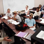 A speech professor gestures while teaching a class at Louisiana Delta Community College.