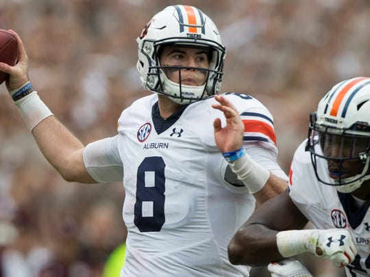 Auburn quarterback Jarrett Stidham (8) passes down field against Texas A&M during the first half of an NCAA college football game on Saturday, Nov. 4, 2017, in College Station, Texas. (AP Photo/Sam Craft)