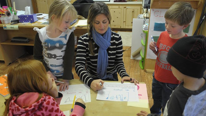 Laurel Parker-Kennedy works with her class at the Custom Learning Academy, a private school in the Donner Tahoe community, in 2010. This year, the Nevada Legislature has approved a bill allowing parents to get school vouchers to send children to private schools.