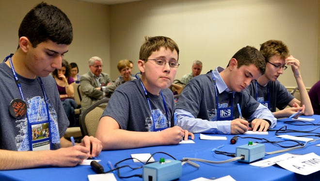 Ames Middle School's Stephen McKown, Hector Arbuckle, Will Tibben and Benjamin Moats prepare for another round of competition during the academic tournament at the 2014 National Science Bowl competition, Saturday, April 26, 2014, in Washington, D.C.