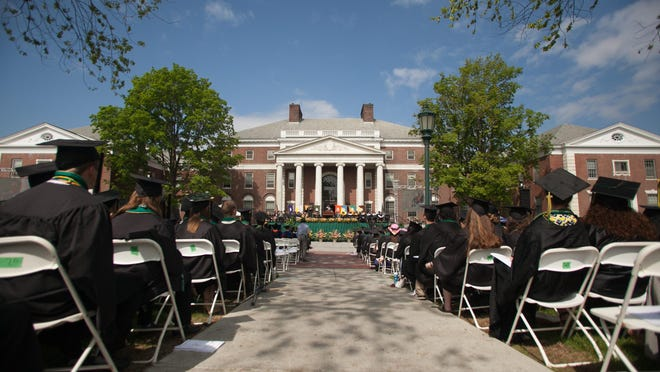 Students attend the University of Vermont commencement ceremony on the UVM green on May 17, 2015.