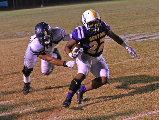 Benton's Jermaine Newton carries the ball in first
