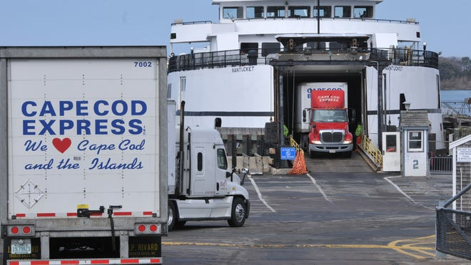 Freight trucks load onto a Steamship Authority ferry from Woods Hole to Martha's Vineyard. The ferry line's board voted Tuesday to keep its 5:30 a.m. run to the island despite concerns voiced by some Woods Hole residents.