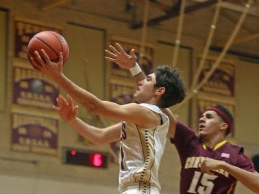 Iona Prep's Ty Jerome drives past Christ the King's Tyrone Cohen during a game at Iona Prep in New Rochelle. Jerome scored 37 points to lead the Gaels to the victory.