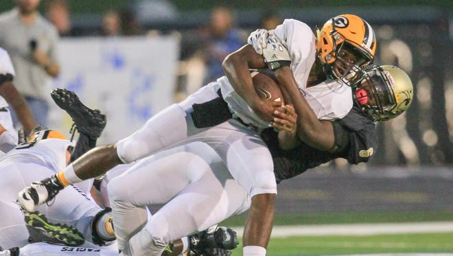 T.L. Hanna's  Zacch Pickens tackles Greenwood's Isaiah Wardlaw during the first quarter at T.L. Hanna High School in Anderson.