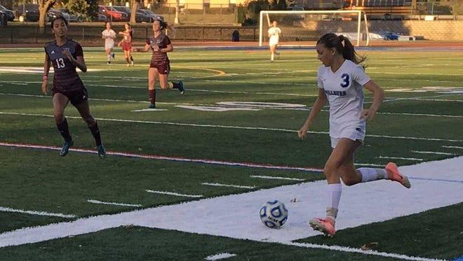 Millburn sophomore Chloe Zegas dribbles the ball upfield in the second half against Nutley.