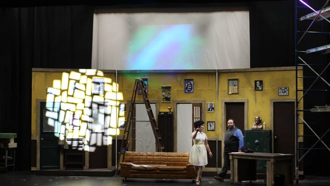 Jennifer Perrino, business manager and producer at  the Warsaw Federal Incline Theater, gives a tour to Sean Matte, an actor and communications manager for Madcap Puppets.