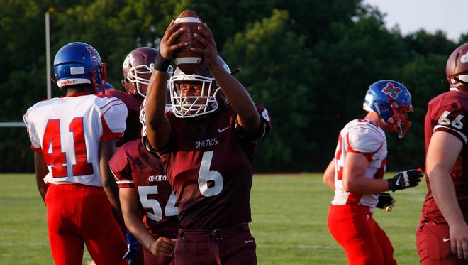 Okemos' Drew McGaughy (6) celebrates one of his touchdowns against Mason on the first play of the second quarter Thursday, Aug. 24, 2017, in Okemos, Mich.