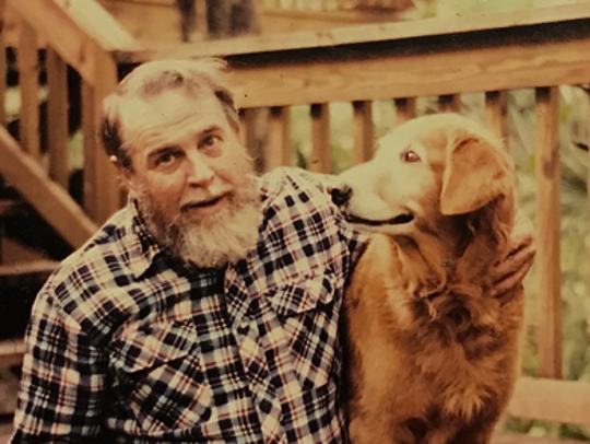 The late Bob Gore and his beloved golden retriever