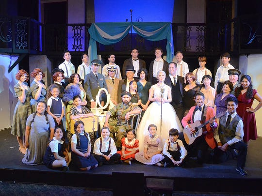 "Palm Canyon Theatre's cast for ""Evita,"" a show that"