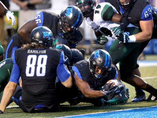 MTSU's Jordan Parker (6) places the ball over the goal line for a touchdown during the first half of thel game against Charlotte Saturday, Sept. 19, 2015, in Murfreesboro.
