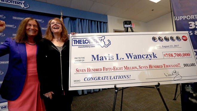 Mavis L. Wanczyk, right, poses with Massachusetts state treasurer Deborah Goldberg  on Aug. 24, 2017, after coming forward only hours after winning the $758 million multi-state Powerball lottery jackpot.
