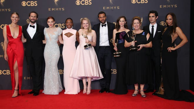 The cast of 'The Handmaid's Tale' pose with their awards for outstanding drama series in the Emmy Awards trophy room.