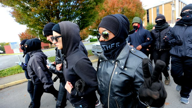 Antifa members march arm in arm to the White Lives Matter rally on the square in Murfreesboro, on Saturday, Oct. 28, 2017.