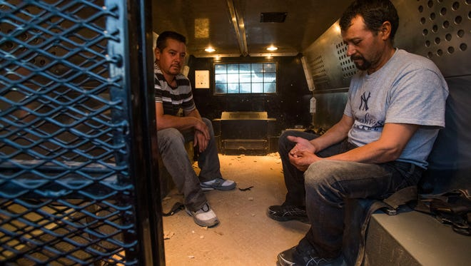 From left, Efrain Rocha and and Javier Luis Sanchez, both agricultural workers from Aguascalientes, Mexico were detained by Customs and Border Protection after entering the U.S. without documentation at the Calexico/Mexicali international border wall on June 19, 2018.