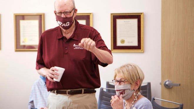 """""""What a blessing I have to get up and go to work each day. I have never dreaded going to work,"""" Happy native Dr. Bob Robinson said during a recent celebration to mark his 50 years of employment with Texas A&M University System."""