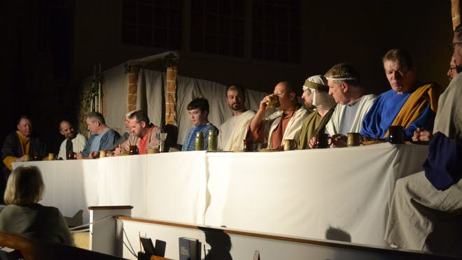 """Jesus of Nazareth, portrayed by Chris Rossmiller, center, watches as his 12 disciples eat and drink at the table in the annual reenactment of """"The Living Last Supper"""" at Pilgrim Congregational Church in Ashwaubenon on Sunday night, March 29."""
