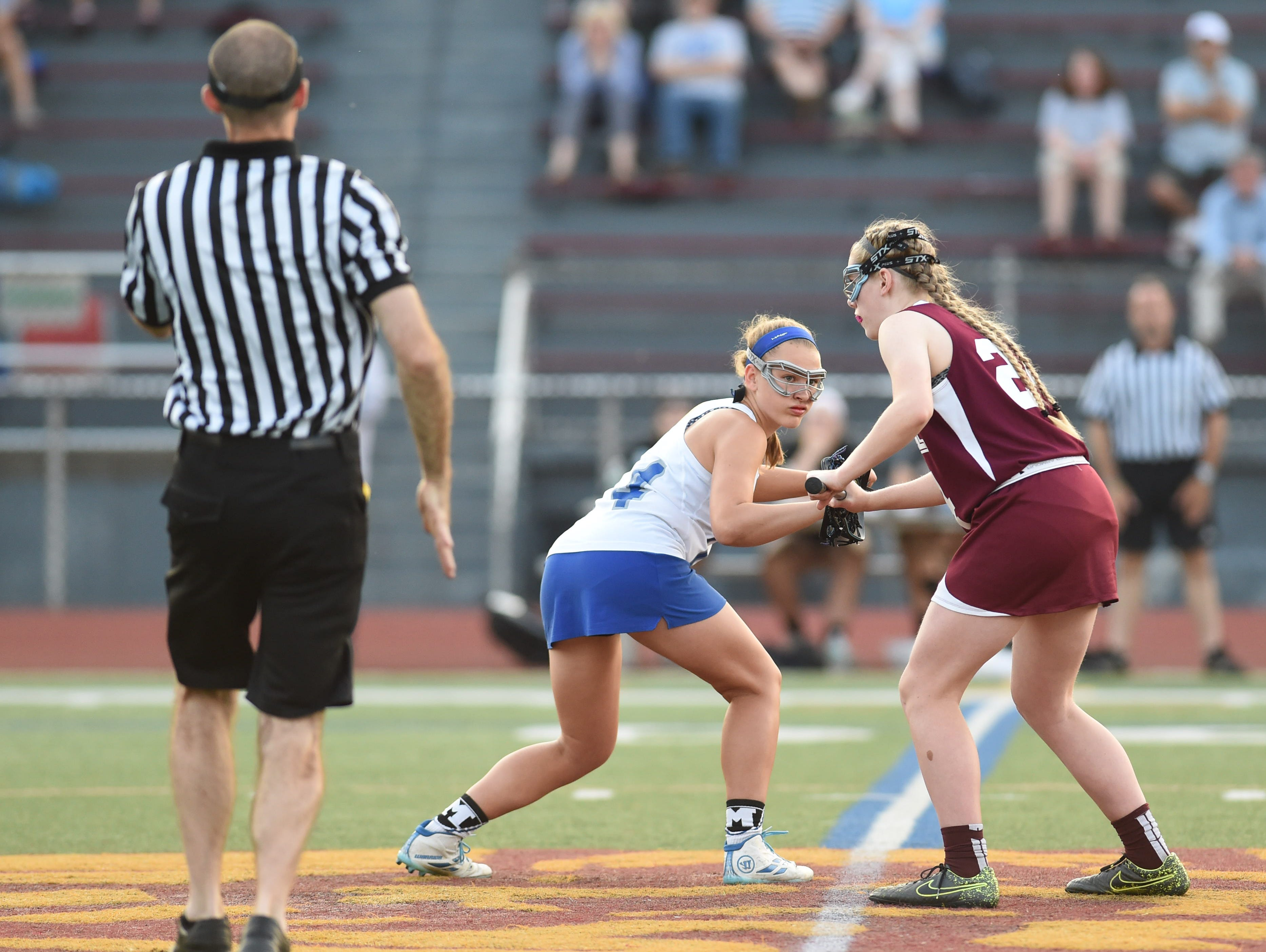 Millbrook's Brooke Babbitt lines up for the draw against James I. O'Neill in the Section 9 Class C girls lacrosse final last May.