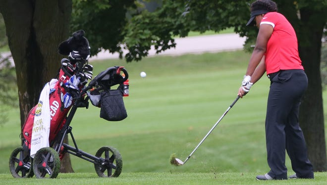 Homestead's Trinidy Pate chips toward the fourth green during the Homestead sectional last year.