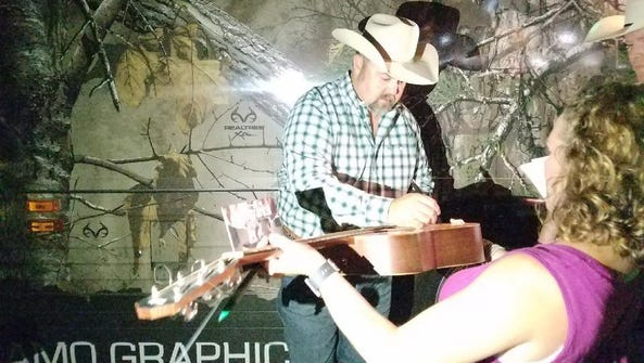 Country music singer Daryle Singletary signs a guitar