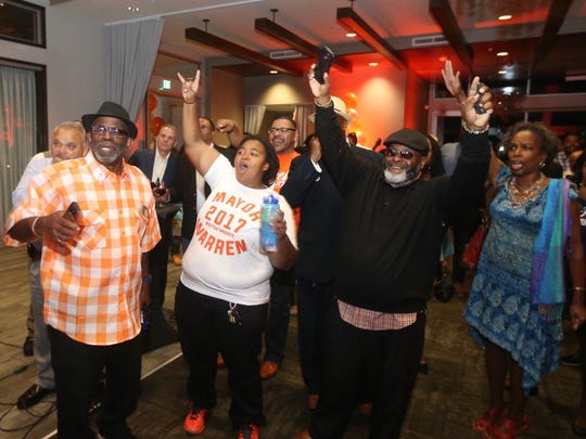 Supporters of Mayor Lovely Warren cheer early elections results.