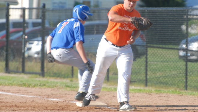 Meadowbrook's Hayden Loy tries to pick off Cambridge JET Auto Juniors base runner Jake Valentine (7) during Tuesday's game in Byesville.