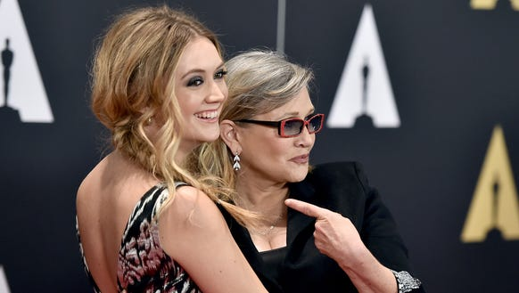 Billie Catherine Lourd, left, and Carrie Fisher arrive