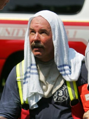 Capt. Steve Kemmlein at the scene of a fire in 2007.