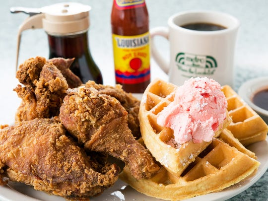 Metro Diner's fried chicken and waffle features a Belgian waffle topped with powdered sugar and sweet strawberry butter.