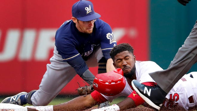 The Cardinals' Dexter Fowler is tagged out at second by the Brewers' Eric Sogard during the first inning Monday night in St. Louis.
